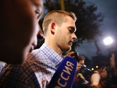 RIO DE JANEIRO, BRAZIL - AUGUST 18:  U.S Olympic swimmers Gunnar Bentz (CENTER) and Jack Conger (NOT PICTURED) leave a police station after being questioned on August 18, 2016 in Rio de Janeiro, Brazil. Ryan Lochte, Gunnar Bentz, Jack Conger and Jimmy Feigen were involved in an altercation at a gas station on Sunday, according to published reports.  Bentz and Conger were detained by Brazilian authorities last night while attempting to fly out of Brazil. Their claims of being victims of a late-night robbery were being questioned by police. (Photo by Mario Tama/Getty Images)