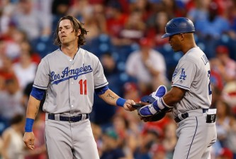 PHILADELPHIA, PA - AUGUST 18: Josh Reddick #11 of the Los Angeles Dodgers hands his helmet to first base coach George Lombard #27 after hitting a long fly for the last out of the top of the third inning of the game against the Los Angeles Dodgers at Citizens Bank Park on August 18, 2016 in Philadelphia, Pennsylvania. (Photo by Brian Garfinkel/Getty Images)