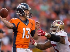 DENVER, CO - AUGUST 20:  Quarterback Trevor Siemian of the Denver Broncos throws a first quarter pass under pressure by outside linebacker Ahmad Brooks of the San Francisco 49ers a preseason NFL game at Sports Authority Field at Mile High on August 20, 2016 in Denver, Colorado. (Photo by Dustin Bradford/Getty Images)