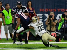 HOUSTON, TX - AUGUST 20: Cecil Shorts #18 of the Houston Texans is tackled by Cortland Finnegan #39 of the New Orleans Saints after a reception during a preseason NFL game at NRG Stadium on August 20, 2016 in Houston, Texas. (Photo by Bob Levey/Getty Images)