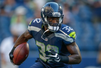 SEATTLE, WA - AUGUST 18:  Running back Christine Michael #32 of the Seattle Seahawks warms up prior to the game against the Minnesota Vikings at CenturyLink Field on August 18, 2016 in Seattle, Washington.  (Photo by Otto Greule Jr/Getty Images)
