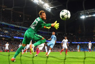 MANCHESTER, ENGLAND - AUGUST 24:  Fabian Delph of Manchester City scores the opening goal past Valentin Cojocaru of Steaua Bucharest during the UEFA Champions League Play-off Second Leg match between Manchester City and Steaua Bucharest at Etihad Stadium on August 24, 2016 in Manchester, England.  (Photo by Michael Regan/Getty Images)