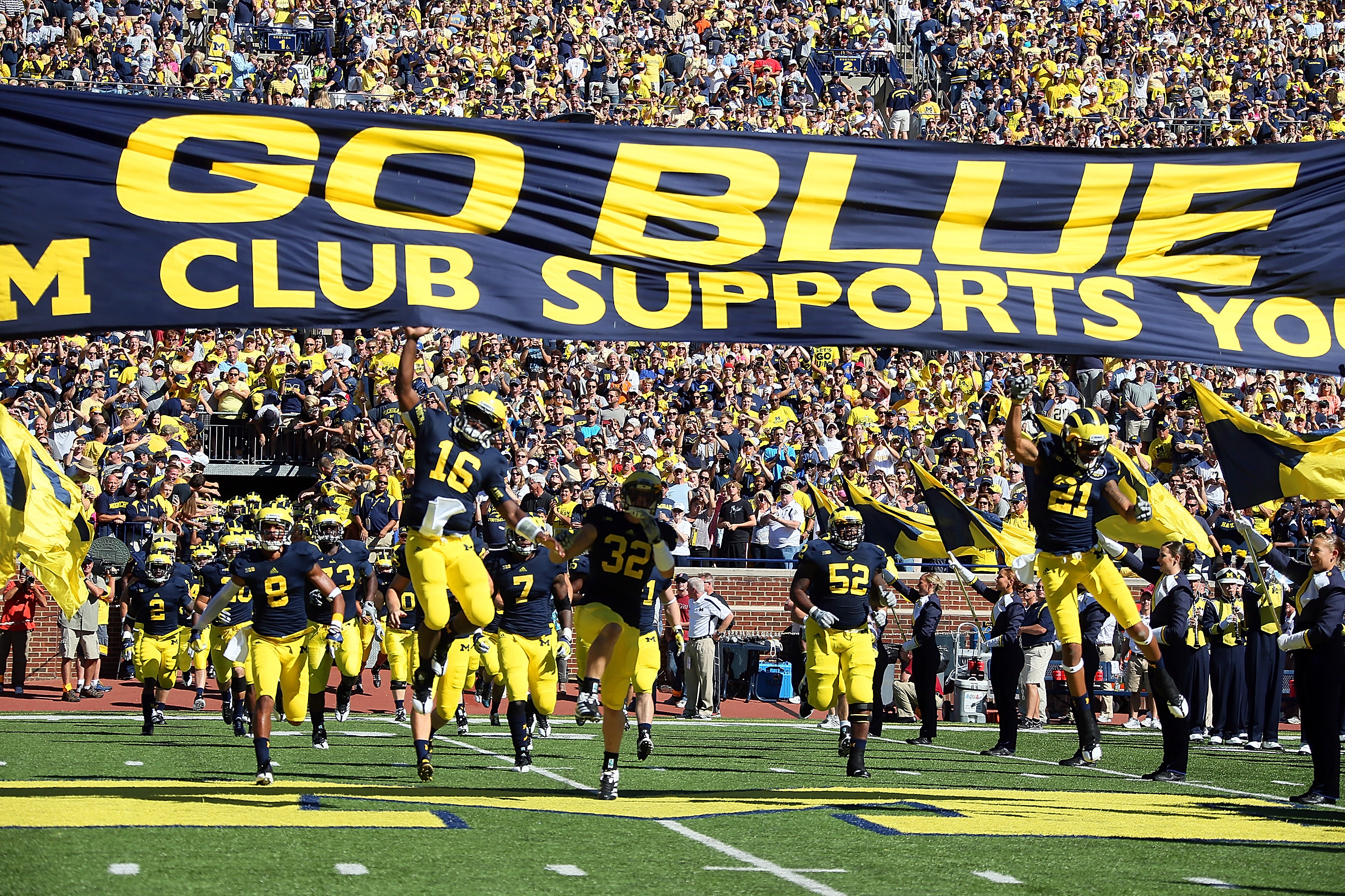 ANN ARBOR, MI - SEPTEMBER 15:  Denard Robinson #16 of the University of Michigan Wolverines leads his team to the field before a Big Ten College football game against the Univerity of Massachusetts Minutemen at Michigan Stadium on September 15, 2012 in Ann Arbor, Michigan.  (Photo by Dave Reginek/Getty Images)