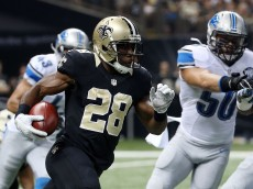 NEW ORLEANS, LA - DECEMBER 21:  C.J. Spiller #28 of the New Orleans Saints is pursued by Travis Lewis #50 of the Detroit Lions during the first half of a game at the Mercedes-Benz Superdome on December 21, 2015 in New Orleans, Louisiana.  (Photo by Chris Graythen/Getty Images)