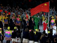 RIO DE JANEIRO, BRAZIL - AUGUST 05:  Flag bearer Sheng Lei of the People's Republic of China leads his team during the Opening Ceremony of the Rio 2016 Olympic Games at Maracana Stadium on August 5, 2016 in Rio de Janeiro, Brazil.  (Photo by Christian Petersen/Getty Images)