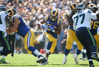 LOS ANGELES, CA - SEPTEMBER 18:  Todd Gurley #30 of the Los Angeles Rams cuts throughthe hole during the second quarter of the home opening NFL game against the Seattle Seahawks at Los Angeles Coliseum on September 18, 2016 in Los Angeles, California.  (Photo by Harry How/Getty Images)