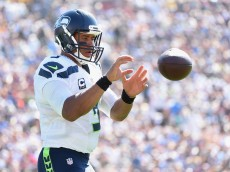 LOS ANGELES, CA - SEPTEMBER 18:  Russell Wilson #3 of the Seattle Seahawks warms up during the fourth quarter of the home opening NFL game between the Los Angeles Rams and the Seattle Seahawks at Los Angeles Coliseum on September 18, 2016 in Los Angeles, California.  (Photo by Harry How/Getty Images)