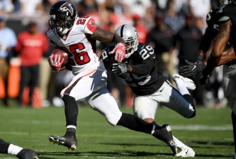 OAKLAND, CA - SEPTEMBER 18:  Tevin Coleman #26 of the Atlanta Falcons runs towards the endzone pulling David Amerson #29 of the Oakland Raiders with him during their NFL game at Oakland-Alameda County Coliseum on September 18, 2016 in Oakland, California.  (Photo by Thearon W. Henderson/Getty Images)