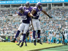CHARLOTTE, NC - SEPTEMBER 25: Danielle Hunter #99 of the Minnesota Vikings celebrates with teammates after sacking Cam Newton #1 of the Carolina Panthers for a safety during the game at Bank of America Stadium on September 25, 2016 in Charlotte, North Carolina.  (Photo by Grant Halverson/Getty Images)