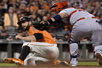 SAN FRANCISCO, CA - SEPTEMBER 16:  Brandon Belt #9 of the San Francisco Giants scores by beating the tag of Yadier Molina #4 of the St. Louis Cardinals in the bottom of the third inning at AT&T Park on September 16, 2016 in San Francisco, California.  (Photo by Thearon W. Henderson/Getty Images)