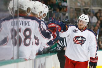 DALLAS, TX - JANUARY 06:  James Wisniewski #21 of the Columbus Blue Jackets celebrates after the Blue Jackets scored a goal against the Dallas Stars in the first period at American Airlines Center on January 6, 2015 in Dallas, Texas.  (Photo by Tom Pennington/Getty Images)