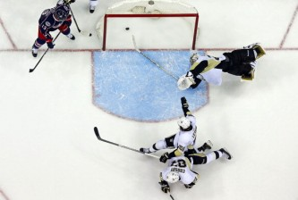 COLUMBUS, OH - APRIL 23:  Cam Atkinson #13 of the Columbus Blue Jackets watches as Brandon Dubinsky #17 of the Columbus Blue Jackets shoots the puck past Sidney Crosby #87, Kris Letang #58, and Marc-Andre Fleury #29, all of the Pittsburgh Penguins, to tie the game at three and send it into overtime during the third period in Game Four of the First Round of the 2014 NHL Stanley Cup Playoffs at Nationwide Arena on April 23, 2014 in Columbus, Ohio. Columbus defeated Pittsburgh 4-3 in overtime. (Photo by Kirk Irwin/Getty Images)