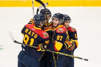 WINDSOR, ON - SEPTEMBER 26: Cole Mayo #91, Connor McDavid #97, Dylan Strome #19 and Alex DeBrincat #12 of the Erie Otters celebrate a goal against the Windsor Spitfires on September 26, 2014 at the WFCU Centre in Windsor, Ontario, Canada. (Photo by Dennis Pajot/Getty Images)