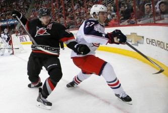 RALEIGH, NC - JANUARY 27:  Ryan Murray #27 of the Columbus Blue Jackets battles for a puck against Jordan Staal #11 of the Carolina Hurricanes at PNC Arena on January 27, 2014 in Raleigh, North Carolina.  (Photo by Kevin C. Cox/Getty Images)