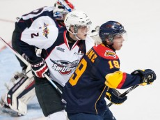 WINDSOR, ON - SEPTEMBER 26: Dylan Strome #19 of the Erie Otters battles out front against Patrick Sanvido #2 of the Windsor Spitfires on September 26, 2014 at the WFCU Centre in Windsor, Ontario, Canada. (Photo by Dennis Pajot/Getty Images)