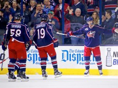 COLUMBUS, OH - APRIL 8:  David Savard #58, and Ryan Johansen #19, skate over to congratulate Boone Jenner #38 all of the Columbus Blue Jackets after scoring a goal during the first period of the game against the Toronto Maple Leafs on April 8, 2015 at Nationwide Arena in Columbus, Ohio. (Photo by Kirk Irwin/Getty Images)