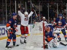 UNIONDALE, NY - APRIL 11: Brandon Dubinsky #17 of the Columbus Blue Jackets celebrates his goal at 9:37 of the third period against Jaroslav Halak #41 of the New York Islanders at the Nassau Veterans Memorial Coliseum on April 11, 2015 in Uniondale, New York. This is the last regular season game to be played in the building as it stands now. The team will relocate to the Barclay's Center in the Brooklyn borough of New York City starting in the 2015-16 season. The Blue Jackets defeated the Islanders 5-4 in the shootout. (Photo by Bruce Bennett/Getty Images)