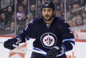 WINNIPEG, MB - MARCH 4: Dustin Byfuglien #33 of the Winnipeg Jets skates down the ice in second period action in an NHL game against the Ottawa Senators at the MTS Centre on March 4, 2015 in Winnipeg, Manitoba, Canada. (Photo by Marianne Helm/Getty Images)