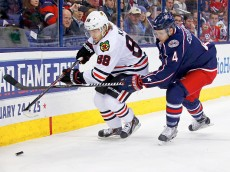 COLUMBUS, OH - DECEMBER 20:  Patrick Kane #88 of the Chicago Blackhawks and Kevin Connauton #4 of the Columbus Blue Jackets battle for control of the puck during the first period at Nationwide Arena on December 20, 2014 in Columbus, Ohio. (Photo by Kirk Irwin/Getty Images)