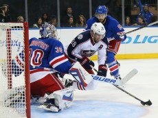 NEW YORK, NY - OCTOBER 10:  Henrik Lundqvist #30 of the New York Rangers makes the first period save on Boone Jenner #38 of the Columbus Blue Jackets at Madison Square Garden on October 10, 2015 in New York City.  (Photo by Bruce Bennett/Getty Images)