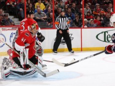 OTTAWA, ON - NOVEMBER 17: Craig Anderson #41 of the Ottawa Senators makes a glove save on a shot by Nick Foligno #71 of the Columbus Blue Jackets during an NHL game at Canadian Tire Centre on November 17, 2013 in Ottawa, Ontario, Canada.  (Photo by Jana Chytilova/Freestyle Photography/Getty Images)