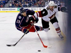 COLUMBUS, OH - NOVEMBER 14:  Cody Goloubef #29 of the Columbus Blue Jackets gets knocked down by Tobias Rieder #8 of the Arizona Coyotes during the first period on November 14, 2015 at Nationwide Arena in Columbus, Ohio. (Photo by Kirk Irwin/Getty Images)