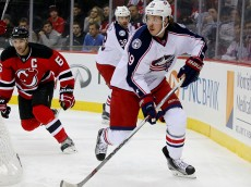 NEWARK, NJ - NOVEMBER 25:  Ryan Johansen #19 of the Columbus Blue Jackets takes the puck as Andy Greene #6 of the New Jersey Devils defends in the first period on November 25, 2015 at the Prudential Center in Newark, New Jersey.  (Photo by Elsa/Getty Images)