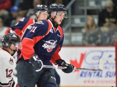 Logan Brown of the Windsor Spitfires. Photo by Terry Wilson / OHL Images.