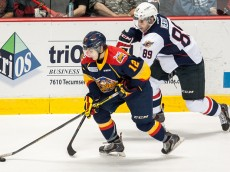 WINDSOR, ON - SEPTEMBER 26: Alex DeBrincat #12 of the Erie Otters battles for the puck against Daniil Vertiy #89 of the Windsor Spitfires on September 26, 2014 at the WFCU Centre in Windsor, Ontario, Canada. (Photo by Dennis Pajot/Getty Images)