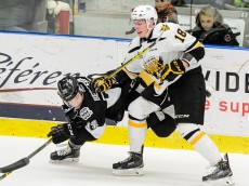 BLAINVILLE-BOISBRIAND, QC - DECEMBER 06:  Pierre-Luc Dubois #18 of the Cape Breton Screaming Eagles takes down Guillaume Bergeron-Charron #72 of the Blainville-Boisbriand Armada during the QMJHL game at the Centre d'Excellence Sports Rousseau on December 6, 2015 in Blainville-Boisbriand, Quebec, Canada.  (Photo by Minas Panagiotakis/Getty Images)