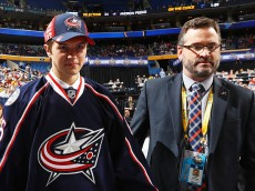 BUFFALO, NY - JUNE 25:  Andrew Peeke reacts after being selected 34th overall by the Columbus Blue Jackets during the 2016 NHL Draft on June 25, 2016 in Buffalo, New York.  (Photo by Bruce Bennett/Getty Images)