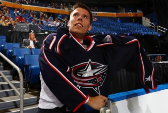 BUFFALO, NY - JUNE 25:  Vitaly Abramov reacts after being selected 65th by the Columbus Blue Jackets during the 2016 NHL Draft on June 25, 2016 in Buffalo, New York.  (Photo by Bruce Bennett/Getty Images)