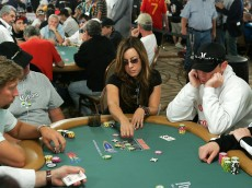 LAS VEGAS - JULY 30:  Actress Jennifer Tilly (C) places a bet on the third day of the first round of the World Series of Poker no-limit Texas Hold 'em main event at the Rio Hotel & Casino July 30, 2006 in Las Vegas, Nevada. More than 8,600 players have registered to play in the main event. The final nine players will compete for the top prize of more than USD 11.7 million on the final table which begins August 10.  (Photo by Ethan Miller/Getty Images)