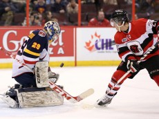 OTTAWA, ON - MARCH 13: Mackenzie Blackwood #29 of the Barrie Colts watches the puck following a save against Dante Salituro #26 of the Ottawa 67's during an OHL game at Canadian Tire Centre on March 13, 2014 in Ottawa, Ontario, Canada.  (Photo by Jana Chytilova/Freestyle Photography/Getty Images)