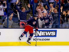 COLUMBUS, OH - OCTOBER 9:  Cam Atkinson #13 of the Columbus Blue Jackets celebrates after beating Henrik Lundqvist #30 of the New York Rangers for a goal during the second period on October 9, 2015 at Nationwide Arena in Columbus, Ohio. (Photo by Kirk Irwin/Getty Images)