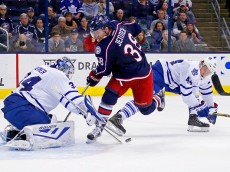 COLUMBUS, OH - OCTOBER 16:  James Reimer #34 of the Toronto Maple Leafs knocks the puck away from Boone Jenner #38 of the Columbus Blue Jackets after slipping past the defense of Morgan Rielly #44 of the Toronto Maple Leafs during the second period on October 16, 2015 at Nationwide Arena in Columbus, Ohio. (Photo by Kirk Irwin/Getty Images)