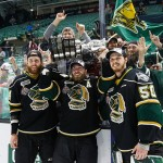 RED DEER, AB - MAY 29:  Jacob Graves #44, Aaron Berisha #72 and goaltender Brendan Burke #50 of the London Knights (OHL) hoist the Memorial Cup with fans after defeating the Rouyn-Noranda Huskies (QMJHL) during the Memorial Cup Final on May 29, 2016 at the Enmax Centrium in Red Deer, Alberta, Canada. (Photo by Codie McLachlan/Getty Images)