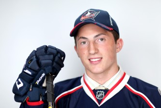 SUNRISE, FL - JUNE 26:  Zach Werenski poses for a portrait after being selected eighth overall by the Columbus Blue Jackets during the 2015 NHL Draft at BB&T Center on June 26, 2015 in Sunrise, Florida.  (Photo by Mike Ehrmann/Getty Images)