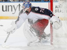 BUFFALO, NEW YORK - APRIL 08:  Joonas Korpisalo #70 of the Columbus Blue Jackets defends the net against the Buffalo Sabres at First Niagara Center on April 8, 2016 in Buffalo, New York. Columbus defeated Buffalo 4-1.  (Photo by Jen Fuller/Getty Images)