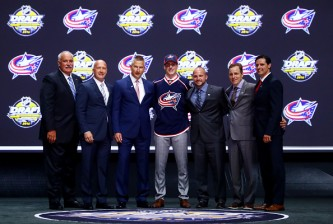 BUFFALO, NY - JUNE 24:  Pierre-Luc Dubois celebrates with the Columbus Blue Jackets after being selected third overall during round one of the 2016 NHL Draft on June 24, 2016 in Buffalo, New York.  (Photo by Bruce Bennett/Getty Images)