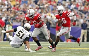 Ezekial Elliot (15) lowering the boom for JT Barrett (16)