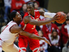 BLOOMINGTON, IN - JANUARY 10: Robert Johnson #4 of the Indiana Hoosiers reaches in as Shannon Scott #3 of the Ohio State Buckeyes holds the ball at Assembly Hall on January 10, 2015 in Bloomington, Indiana. Indiana defeated Ohio State 69-66. (Photo by Michael Hickey/Getty Images)