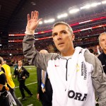 ARLINGTON, TX - JANUARY 12:  (L-R) Head Coach Urban Meyer of the Ohio State Buckeyes celebrates after defeating the Oregon Ducks 42 to 20 in the College Football Playoff National Championship Game at AT&T Stadium on January 12, 2015 in Arlington, Texas.  (Photo by Tom Pennington/Getty Images)