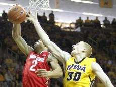 IOWA CITY, IA - JANUARY 17:  Forward Marc Loving #2 of the Ohio State Buckeye battles for a rebound with forward Aaron White #30 of the Iowa Hawkeyes in the first half on January 17, 2015 at Carver-Hawkeye Arena in Iowa City, Iowa.  (Photo by Matthew Holst/Getty Images)