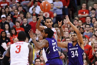 COLUMBUS, OH - FEBRUARY 19:  LaQuinton Ross #10 of the Ohio State Buckeyes passes to teammate Shannon Scott #3 in the first half as JerShon Cobb #23 and Sanjay Lumpkin #34 of the Northwestern Wildcats defend on February 19, 2014 at Value City Arena in Columbus, Ohio.  (Photo by Jamie Sabau/Getty Images)