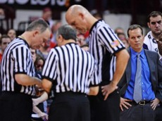 COLUMBUS, OH - FEBRUARY 19:  Head coach Chris Collins of the Northwestern Wildcats watches as the referees attempt to sort out fouls to be assessed after a scuffle between players from the Wildcats and the Ohio State Buckeyes in the second half on February 19, 2014 at Value City Arena in Columbus, Ohio. Ohio State defeated Northwestern 76-60.  (Photo by Jamie Sabau/Getty Images)