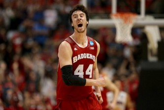 ANAHEIM, CA - MARCH 29:  Frank Kaminsky #44 of the Wisconsin Badgers celebrates after making a three-pointer in the second half while taking on the Arizona Wildcats during the West Regional Final of the 2014 NCAA Men's Basketball Tournament at the Honda Center on March 29, 2014 in Anaheim, California.  (Photo by Jeff Gross/Getty Images)