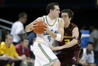 LOS ANGELES - JANUARY 16:  Jon Crispin #5 of the UCLA Bruins is defended by Kyle Dodd #3 of the Arizona State Sun Devils during their NCAA game on January 16, 2003 at Pauley Pavilion in Los Angeles, California. Arizona State defeated UCLA 75-64.  (Photo by Jeff Gross/Getty Images)