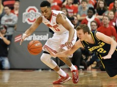 COLUMBUS, OH - JANUARY 13:  D'Angelo Russell #0 of the Ohio State Buckeyes and Spike Albrecht #2 of the Michigan Wolverines battle for control of a loose ball in the second half on January 13, 2015 at Value City Arena in Columbus, Ohio. Ohio State defeated Michigan 71-52.  (Photo by Jamie Sabau/Getty Images)