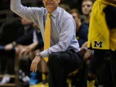 MILWAUKEE, WI - MARCH 22:  Head coach John Beilein of the Michigan Wolverines points against the Texas Longhorns during the third round of the 2014 NCAA Men's Basketball Tournament at BMO Harris Bradley Center on March 22, 2014 in Milwaukee, Wisconsin.  (Photo by Jonathan Daniel/Getty Images)